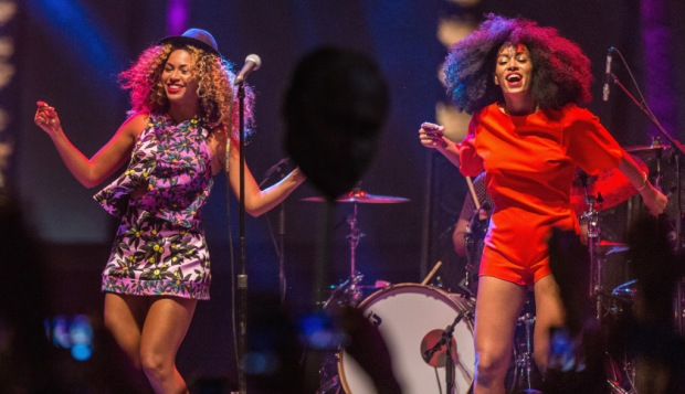 INDIO, CA - APRIL 12:  Singer Beyonce (L) performs with her sister Solange onstage during day 2 of the 2014 Coachella Valley Music & Arts Festival at the Empire Polo Club on April 12, 2014 in Indio, California.  (Photo by Christopher Polk/Getty Images for Coachella)